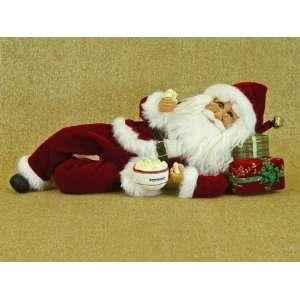 Santa Claus by Karen Didion originals laying Santa Claus figurine with