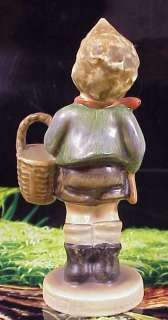 We are pleased to offer this lovely Hummel entitled Village Boy.