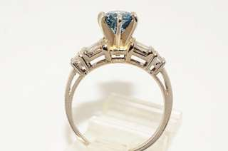 detailed description of item irradiated center round cut blue diamond
