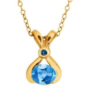0.83 Ct Oval Swiss Blue Topaz and Blue Diamond 14k Yellow