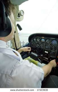 Pilot In Cockpit Flying An Airplane Stock Photo 17323930