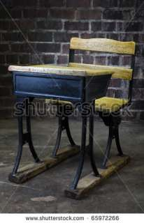 black and yellow crack paint old school desk with brick background